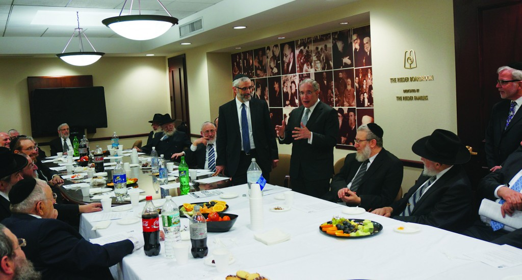 """Rabbi Chaim Dovid Zwiebel on Wednesday night greets City Comptroller Scott Stringer to Agudath Israel's Manhattan headquarters. """"Without the support of the Orthodox Jewish community,"""" Stringer said, """"I would not be standing here as the elected comptroller."""""""