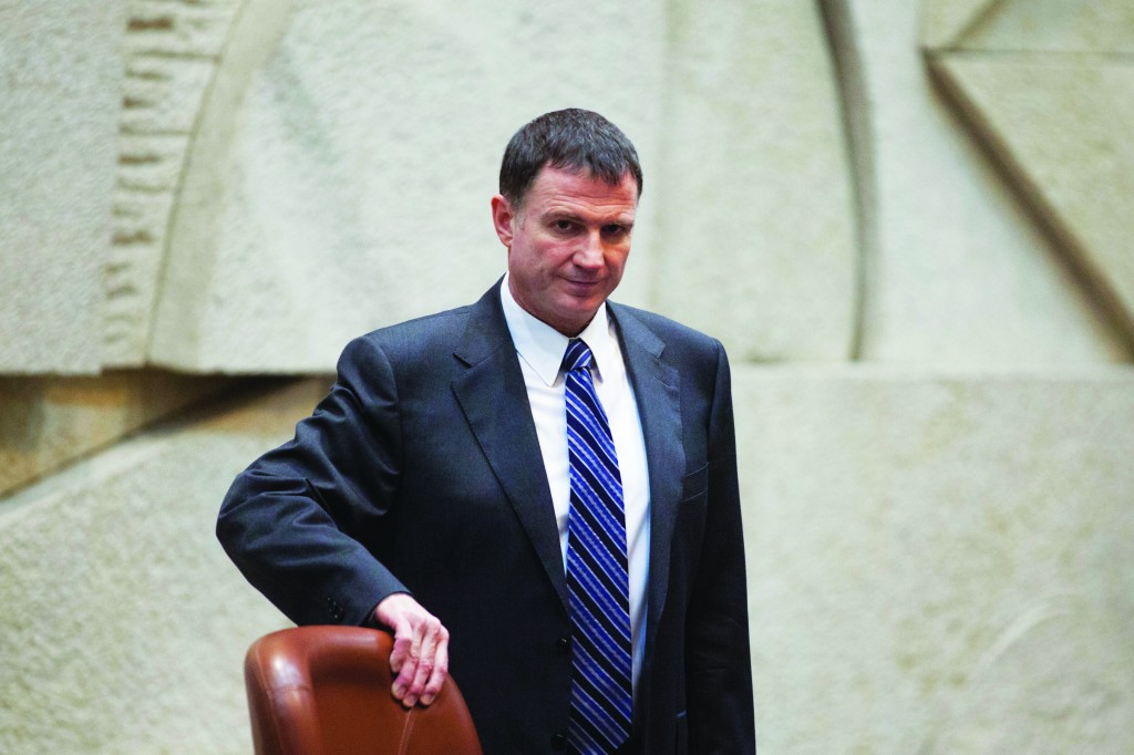 A chagrined Knesset speaker, Yuli Edelstein, at the empty plenum on Monday. (Flash90)