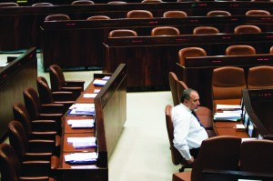 Israel's Foreign Minister Avigdor Lieberman attends a session in the empty plenum of the Knesset as opposition parties boycotted on Monday. (Flash90)