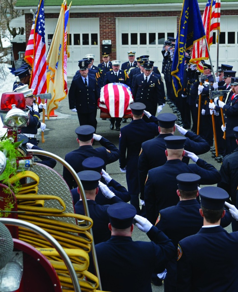 The casket of Captain Greg Barnas of the Wallington, N.J., Fire Department on Friday at his funeral procession. The 57-year-old died after he fell from the roof while working to put out a fire the week before. (AP Photo/The Record, Tariq Zehawi)