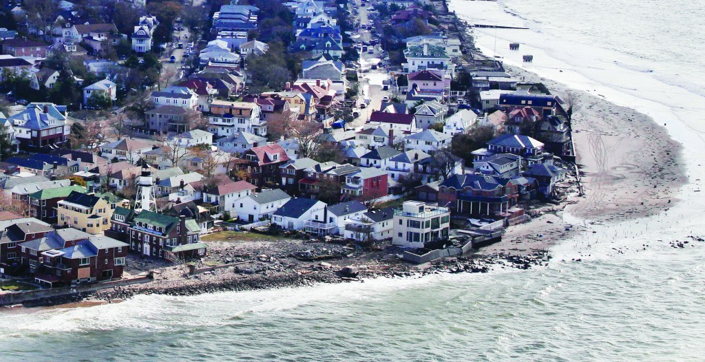 An aerial photo of Sea Gate after Superstorm Sandy slammed through it in 2012. (AP Photo/Mark Lennihan)