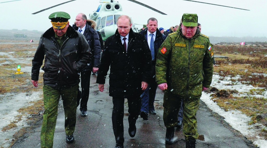 Russian President Vladimir Putin (C) and Defense Minister Sergei Shoigu (L) and the commander of the Western Military District Anatoly Sidorov (R) walk upon arrival to watch military exercise near St.Petersburg, Russia, Monday. (AP Photo/RIA-Novosti, Mikhail Klimentyev, Presidential Press Service)