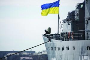 Ukrainian Navy sailors stand guard on the Ukrainian navy command ship Slavutych at the Crimean port of Sevastopol Tuesday. (REUTERS/Baz Ratner)