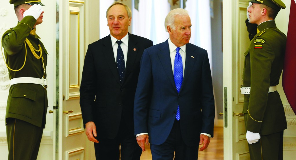 Vice President Joe Biden (R) and Latvia's President Andris Berzins (L) walk together prior to their meeting at the Presidential palace in Vilnius, Lithuania, Wednesday. (AP Photo/Mindaugas Kulbis)