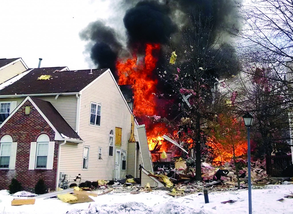 Flames and smoke shoot up after an explosion Tuesday in Ewing, N.J. (AP Photo/Josh Forst)