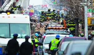Scenes at the site of an explosion that leveled two apartment buildings in East Harlem. (AP Photos)