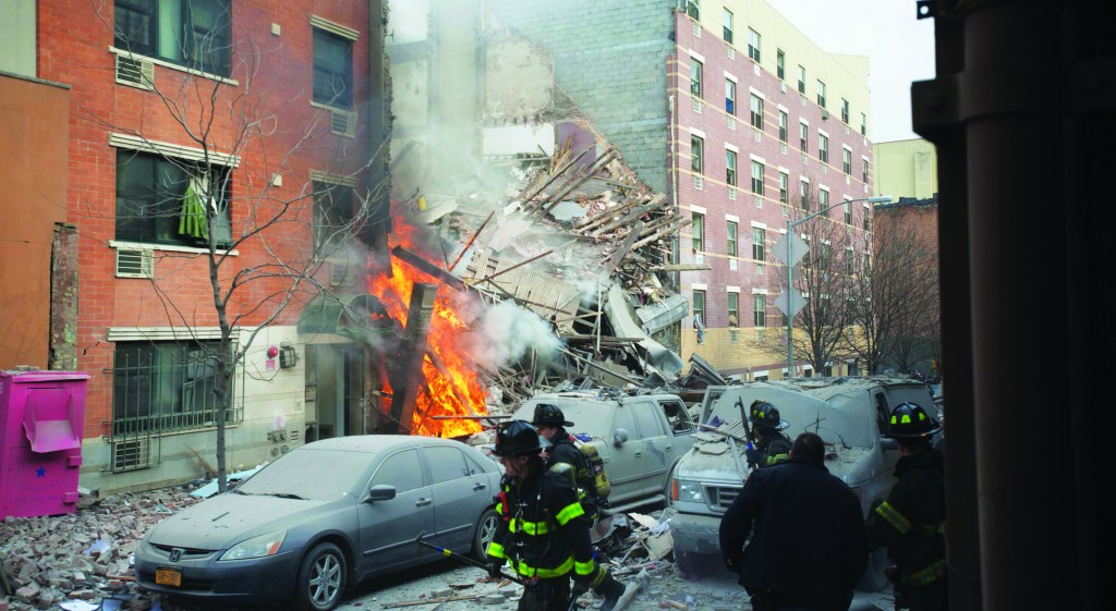 Firefighters respond to the explosion that leveled two apartment buildings in East Harlem. (AP Photos)