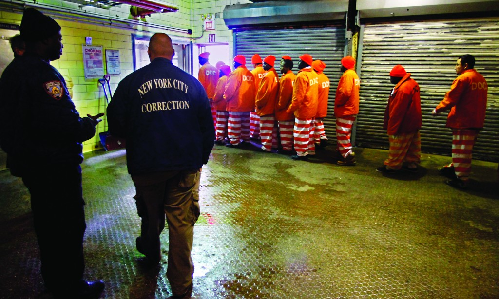 In this file photo, inmates file out of the prison bakery at Rikers Island after working the morning shift. (AP Photo/Bebeto Matthews )