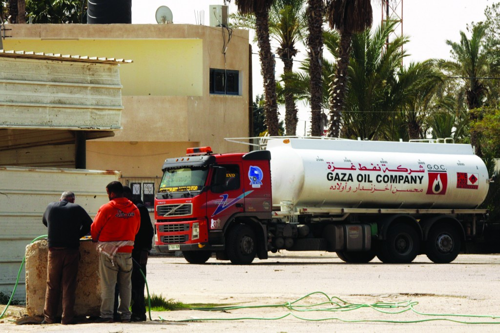 A Palestinian truck carrying fuel for the Gaza Strip enters Rafah town through the Kerem Shalom crossing between Israel and the southern Gaza Strip. (Abed Rahim Khatib/Flash90)
