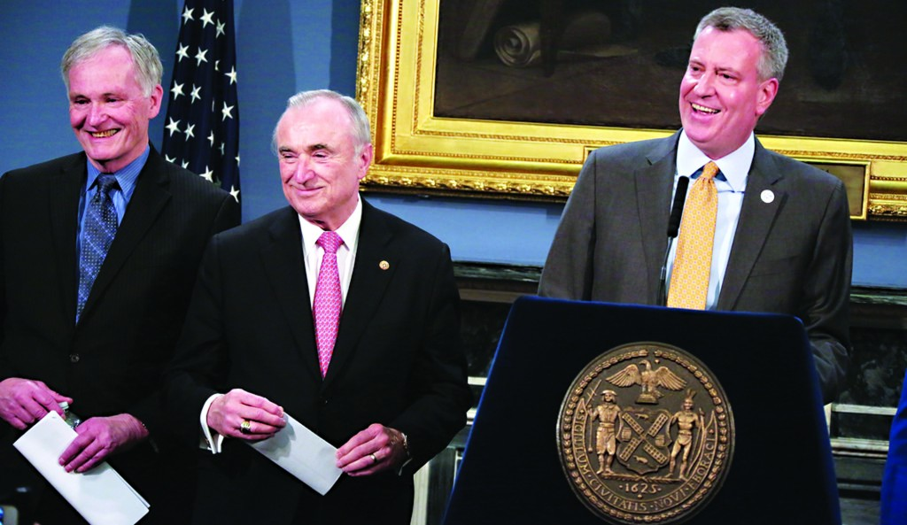 Mayor Bill de Blasio (R) announces the appointment of Joseph Ponte (L) as department of corrections commissioner at a City Hall press conference Tuesday. NYPD Commissioner William Bratton is in the center. (Ed Reed/City Hall)