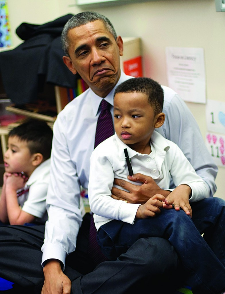President Barack Obama sits with Marcus Wesby and other preschool student during his visit to Powell Elementary School in the Petworth neighborhood of Washington, Tuesday, March 4, 2014. Obama visited the school to talk about his 2015 budget proposal, which was released today. (AP Photo/Pablo Martinez Monsivais)