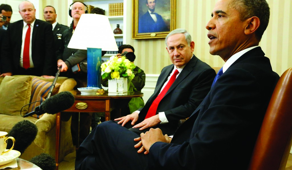 Israel's Prime Minister Binyamin Netanyahu listens to remarks by U.S. President Barack Obama as they sit down to meet in the Oval Office of the White House in Washington on Monday. (REUTERS/Jonathan Ernst)