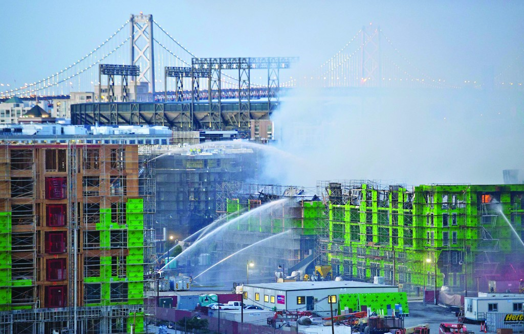 A partly-built high-rise tower in San Francisco whose upper floors collapsed in a major fire on Tuesday was in danger of collapsing further, and a nearby apartment building remained evacuated, a fire official said on Wednesday. A five-alarm blaze that may have been caused by a welding mishap broke out late on Tuesday at the MB360 apartment complex under construction in the Mission Bay district, said San Francisco Fire Department spokeswoman Mindy Talmadge. (REUTERS/Noah Berge)