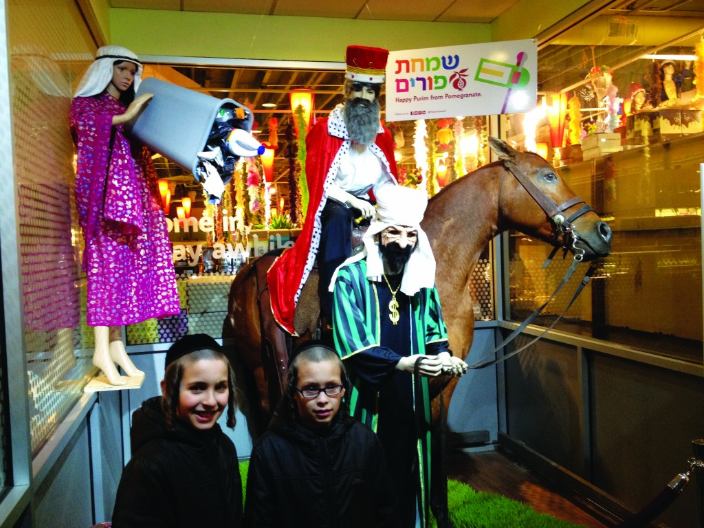 Children shop on 13th Ave. for Purim costumes. (JDN)