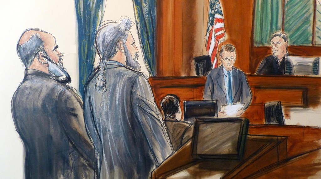 In this courtroom sketch, Osama bin Laden's son-in-law, Sulaiman Abu Ghaith  stands next to his attorney, Stanley Cohen, Wednesday, March 26, 2014. (AP Photo/Elizabeth Williams)