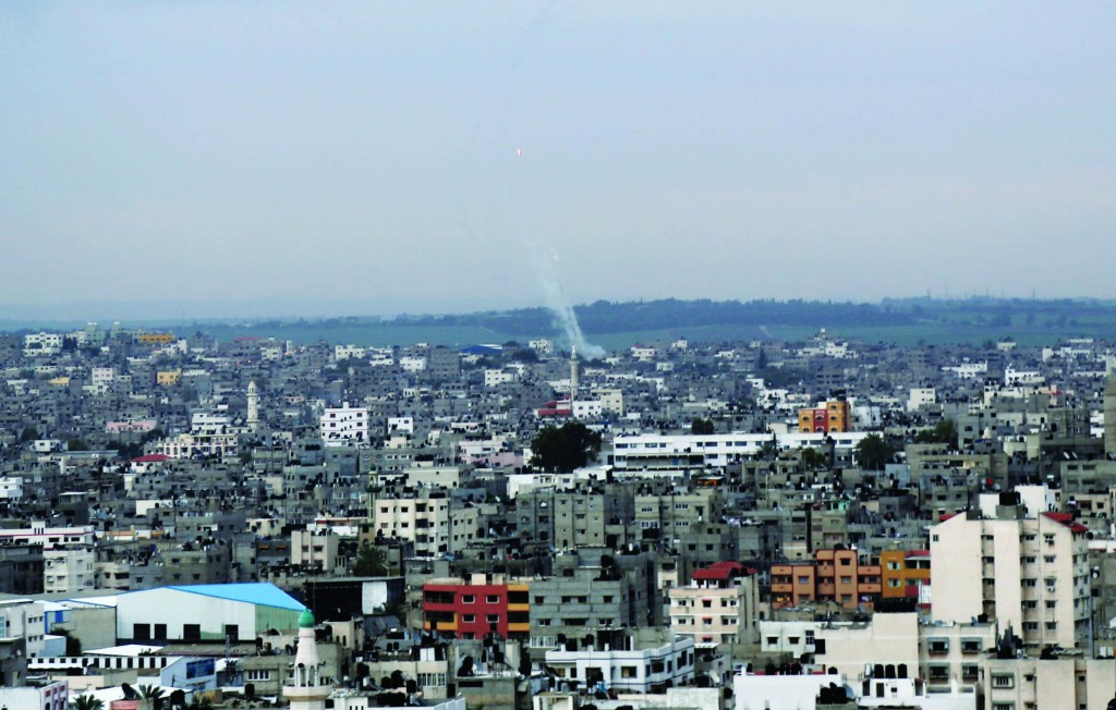 A trail of smoke seen over Gaza City from rockets fired by Palestinian terrorists on southern Israel on Wednesday. (AP Photo/Adel Hana)