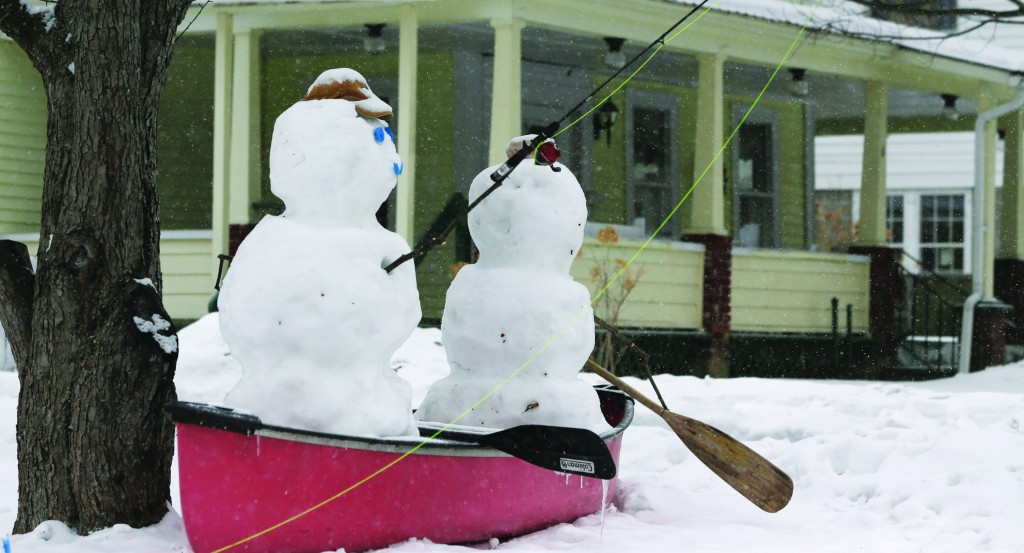 Snowmen fish in a canoe Wednesday in Schroon Lake, N.Y. (AP Photo/Mike Groll)