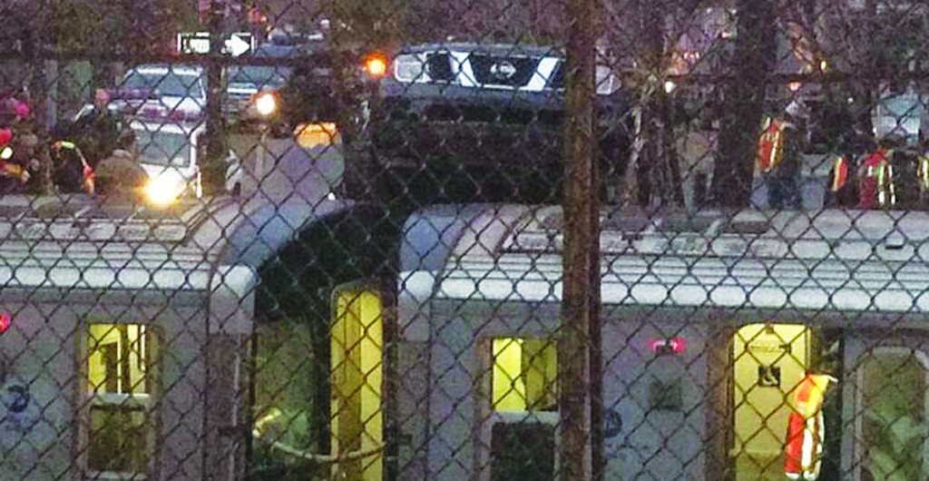 An SUV Wednesday morning rests atop a Q train on East 16th Street and Albermarle Road.