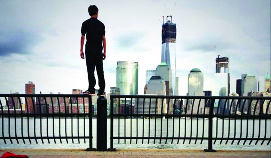 Justin Casquejo stands on a fence facing the World Trade Center in this picture posted online.