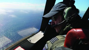 Royal New Zealand Air Force P-3 Orion's captain, Wing Comdr. Rob Shearer watches out of the window of his aircraft while searching for the missing Malaysia Airlines Flight MH370 in the southern Indian Ocean. (AP Photo/Rob Griffith, Pool)