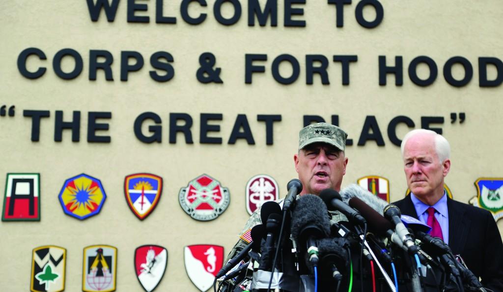Lt. Gen. Mark Milley (L) U.S. Sen. John Cornyn (R) talk to the media near Fort Hood's main gate, Thursday, in Fort Hood, Texas. (AP Photo/Eric Gay)