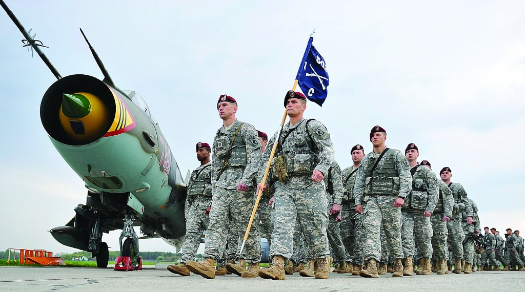 U.S. paratroopers on the tarmac after being flown into Swidwin, Poland, on Wednesday, for weeks of joint exercise. Their arrival was requested by Poland as a way of increasing security at a time of conflict between two of its neighbors: Ukraine and Russia. (AP Photo/Lukasz Szelemej)