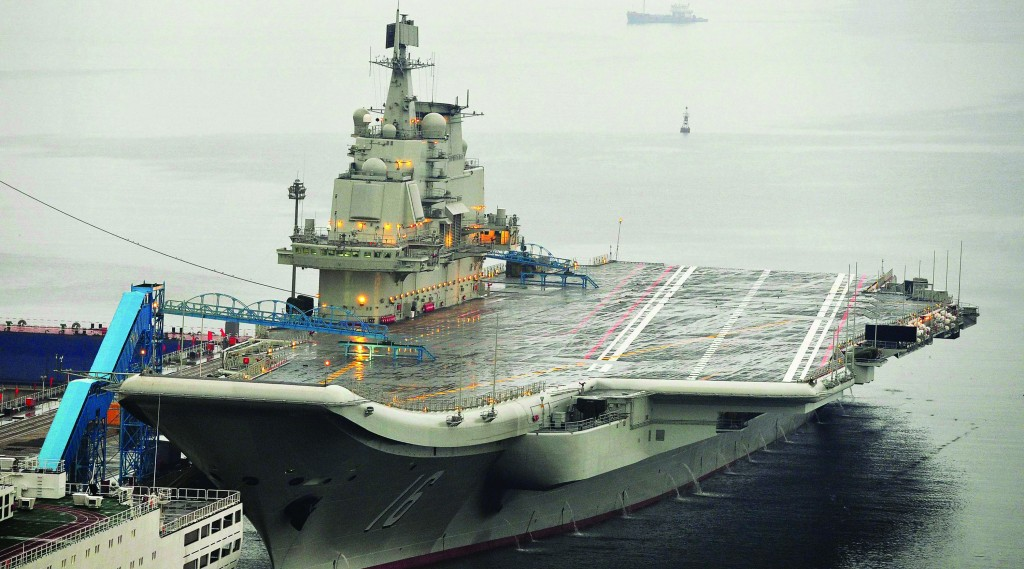 China's first aircraft carrier, renovated from an old aircraft carrier that China bought from Ukraine in 1998, is seen docked at Dalian Port, in Dalian, Liaoning province. (REUTERS/Stringer/Files)