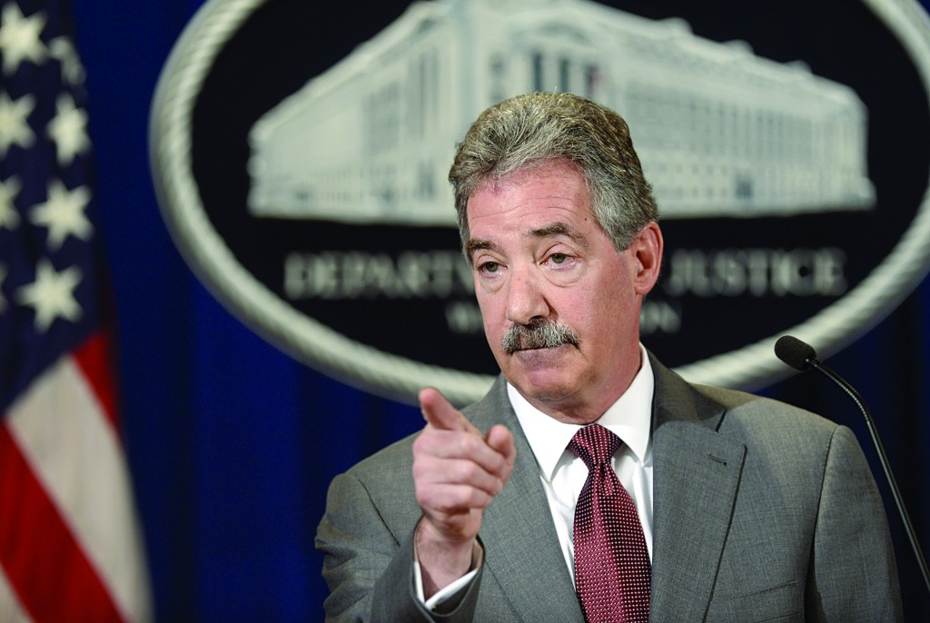 Deputy Attorney General James Cole gestures during a news conference at the Justice Department in Washington, Wednesday (AP Photo/Susan Walsh)