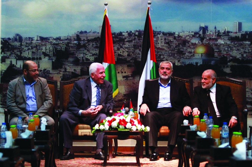 Senior Hamas leader Moussa Abu Marzouk (L); senior Fatah official Azzam Al-Ahmed (2nd L); head of the Hamas government Ismail Haniyeh (3rd L) and deputy speaker of Palestinian Parliament Ahmed Bahar attend a meeting in Gaza City. (Abed Rahim Khatib/Flash90)