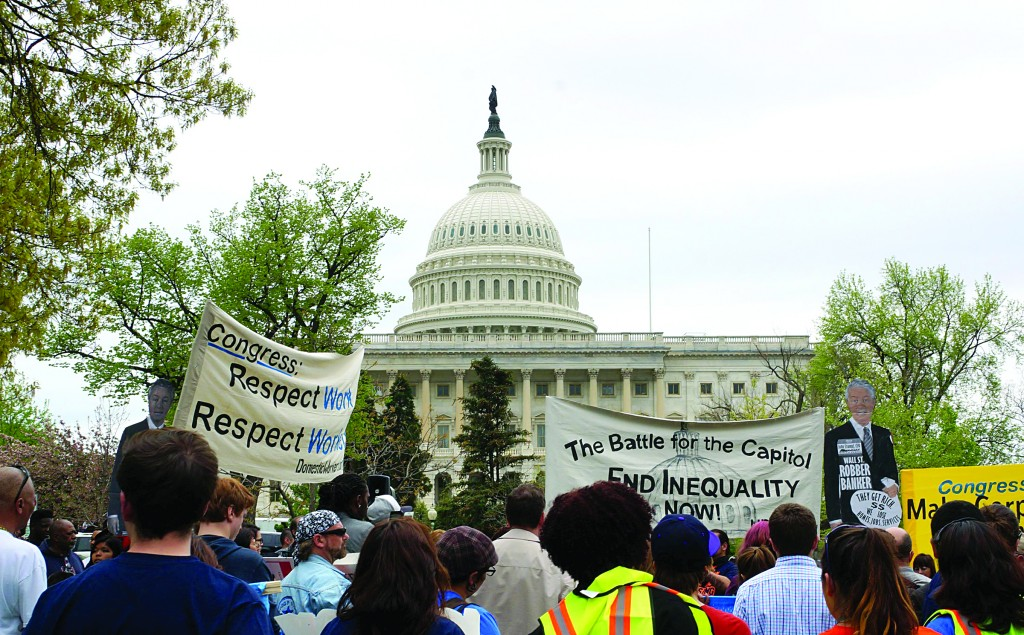 Protestors demonstrate at the Capitol addressing income inequality, minimum wage and ending tax breaks for corporations on Monday, in Washington, DC. (Tish Wells/MCT)