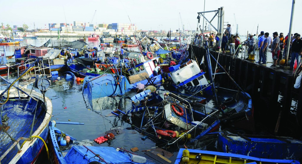 Fishing boats washed ashore by a small tsunami in Iquique, Chile, after a magnitude 8.2 earthquake struck late Tuesday night off Chile's northern coast. (AP Photo/Cristian Viveros)