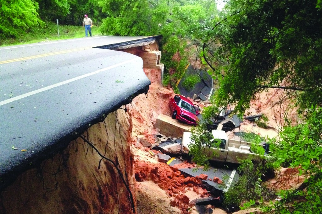 (Top) Vehicles rest at the bottom of a ravine after the Scenic Highway collapsed near Pensacola, Fla., Wednesday. (Lower left) A wrecking crew tries to lift a car out of the parking lot of the Okaloosa County Jail in Crestview, Fla., after flood waters washed out a portion of the concrete. (Lower right) Floodwaters in a Cordova Park neighborhood in Pensacola, Fla., Wednesday.  (AP Photo)