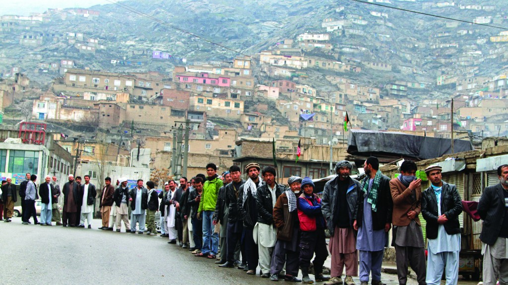 Afghans line up outside a polling station to cast their ballots, in Kabul, Afghanistan, Saturday. (AP Photo/Rahmatullah Nikzad)