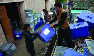 Afghan workers of the election commission office unload ballot boxes from a truck after votes in Jalalabad, east of Kabul, Afghanistan, Sunday. (AP photo/Rahmat Gul)