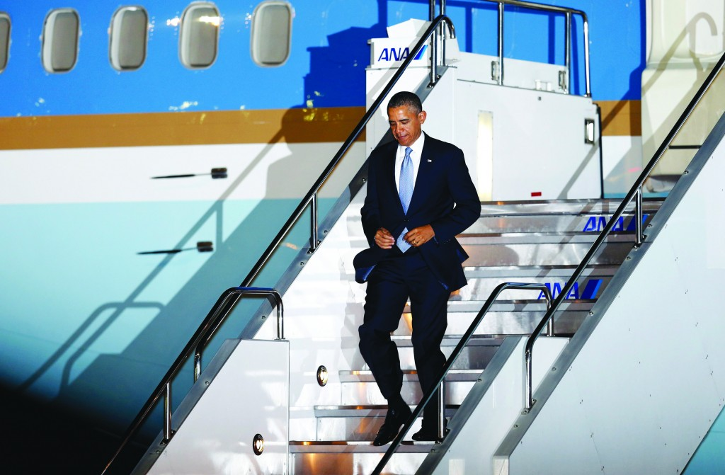 President Obama steps down the ramp upon his arrival at Haneda International Airport in Tokyo, Wednesday.  (AP Photo/Shizuo Kambayashi)