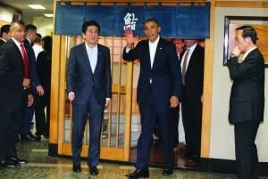 President Barack Obama and Japanese Prime Minister Shinzo Abe leave after having dinner at Sukiyabashi Jiro sushi restaurant in Tokyo, Wednesday. (AP Photo/Carolyn Kaster)