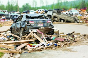 Piles of mangled cars and destroyed homes sit along Aspen Creek Drive in the Parkwood Neighborhood off Naylor Road in Vilonia, Ark., Monday (AP Photo/Karen E. Segrave)