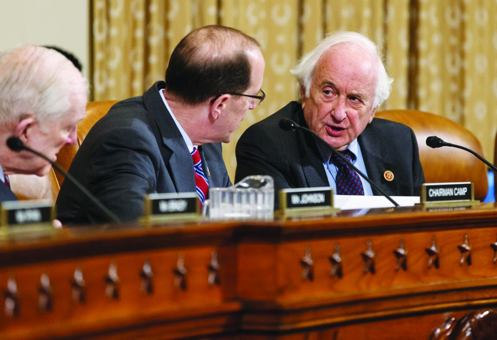 House Ways and Means Committee Chairman Rep. Dave Camp (R-Mich.) and Rep. Sander Levin (D-Mich.), the ranking member (R) exchange words Wednesday during a disagreement over IRS official Lois Lerner. (AP Photo/J. Scott Applewhite)