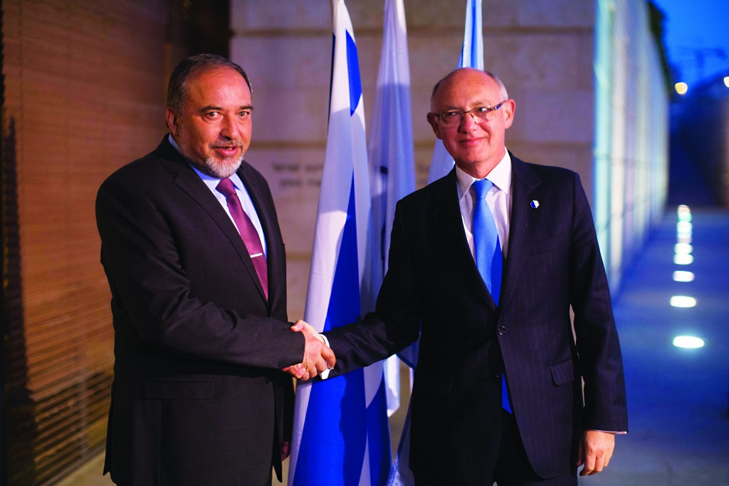 Israeli Foreign Minister Avigdor Lieberman (L) meets with Argentinian Foreign Minister, Hector Timerman, in Yerushalayim on Monday. (Yonatan Sindel/Flash90)