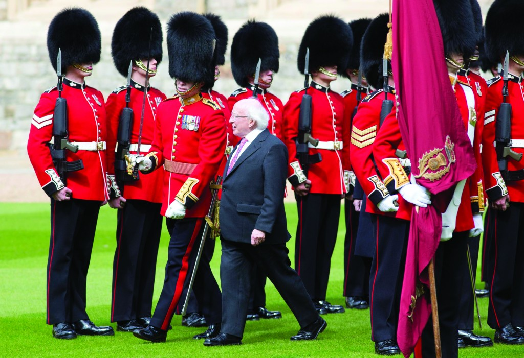 Irish President Michael D. Higgins inspects a Guard of Honor at Windsor Castle, Tuesday. (AP Photo/Neil Hall)