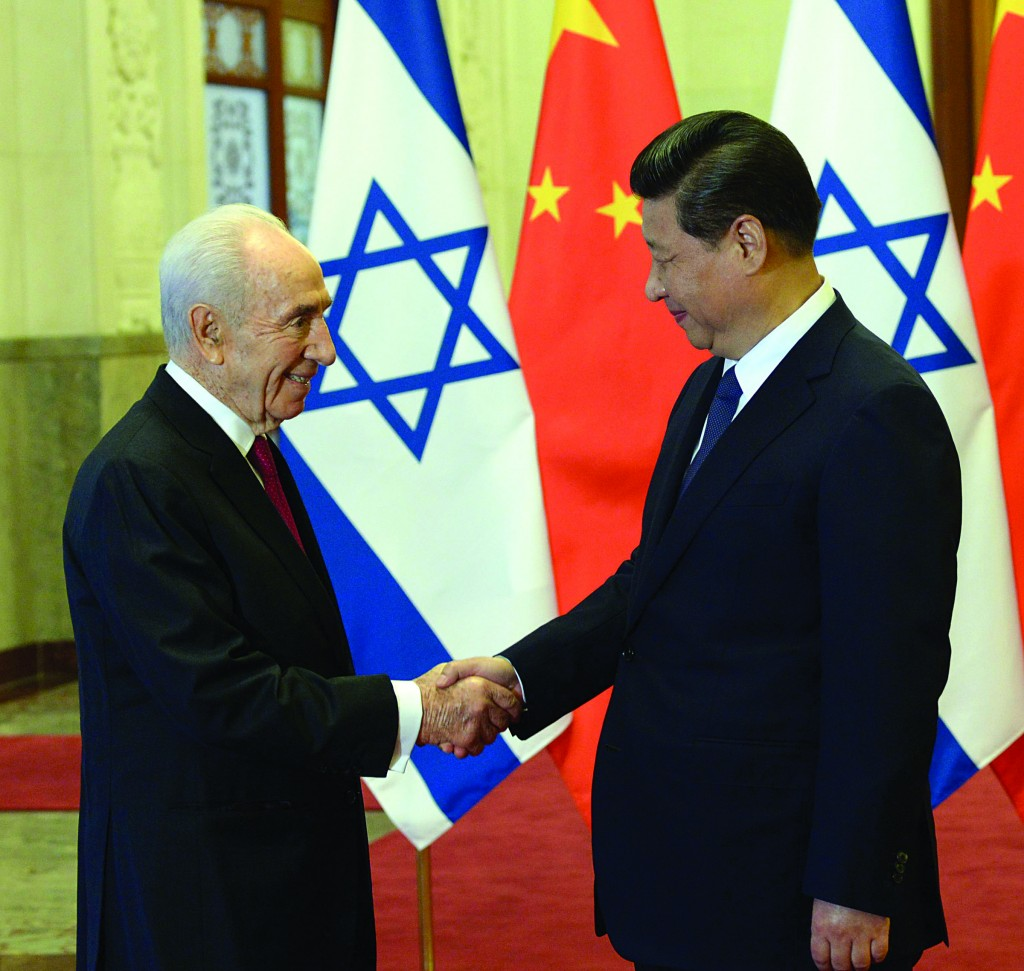 Israeli President Shimon Peres with Chinese President Xi Jinping in Beijing, during Peres' recent state visit, reflected the country's turn to Asia for economic ties. (Amos Ben Gershom/GPO/Flash 90)