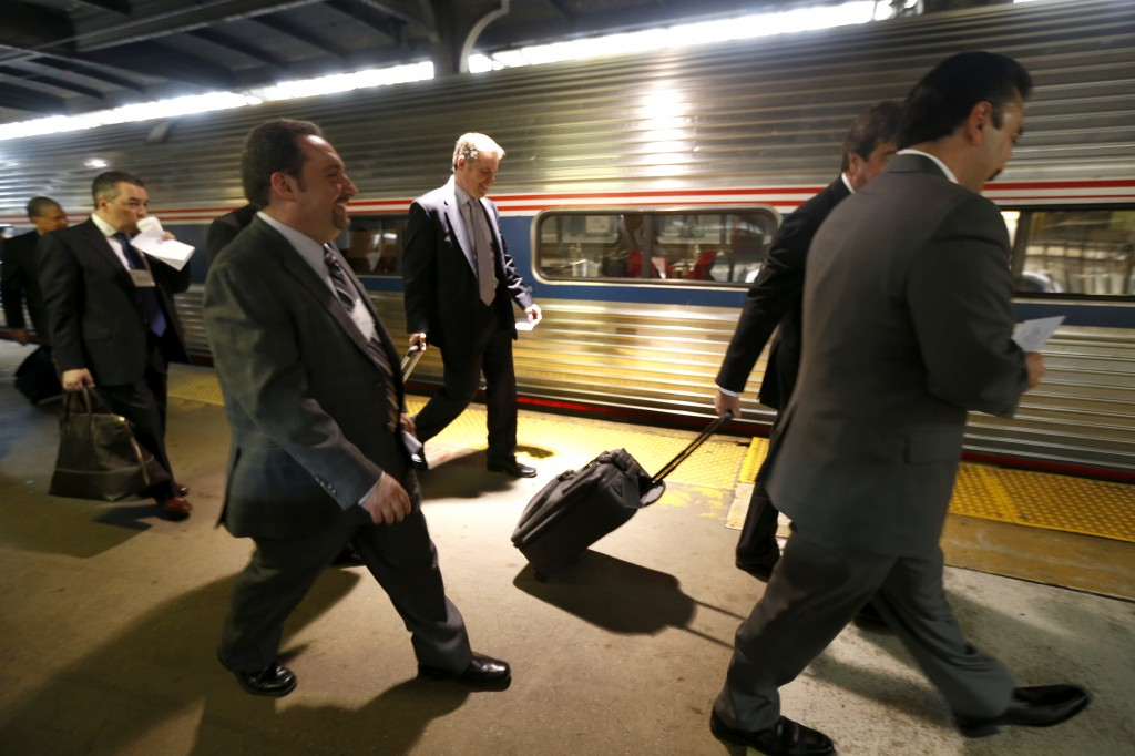 """New Jersey Assembly Speaker Vincent Prieto (R) walks toward a train in Newark while participating in the """"Walk to Washington"""" train ride Tuesday. (AP Photo/Julio Cortez)"""