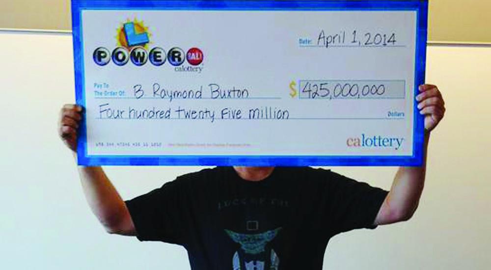 Powerball winner B. Raymond Buxton holding a check for $425 million Tuesday. (AP Photo/California Lottery)