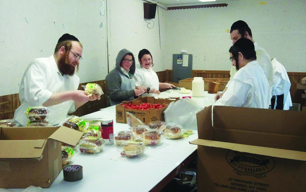 Sandwich makers at Ess N Bench in Boro Park prepare their sandwiches during one of the busiest seasons of the year. (JDN)
