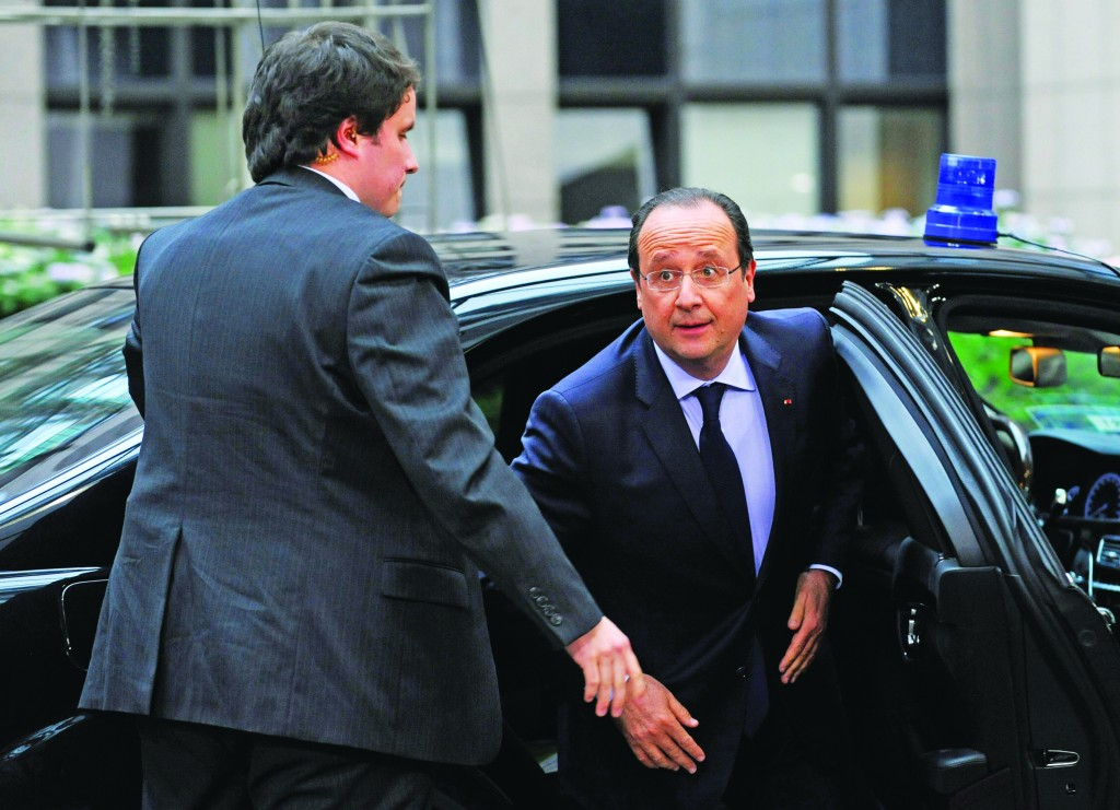 French President Francois Hollande steps out of his car upon arrival at the European Council building in Brussels, Tuesday (AP Photo/Eric Vidal)