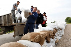 Bosnian people place sandbags onto roads to protect the city from flooding near Orasje, 200 kms north of Sarajevo, on Sunday  (AP Photo/Amel Emric)