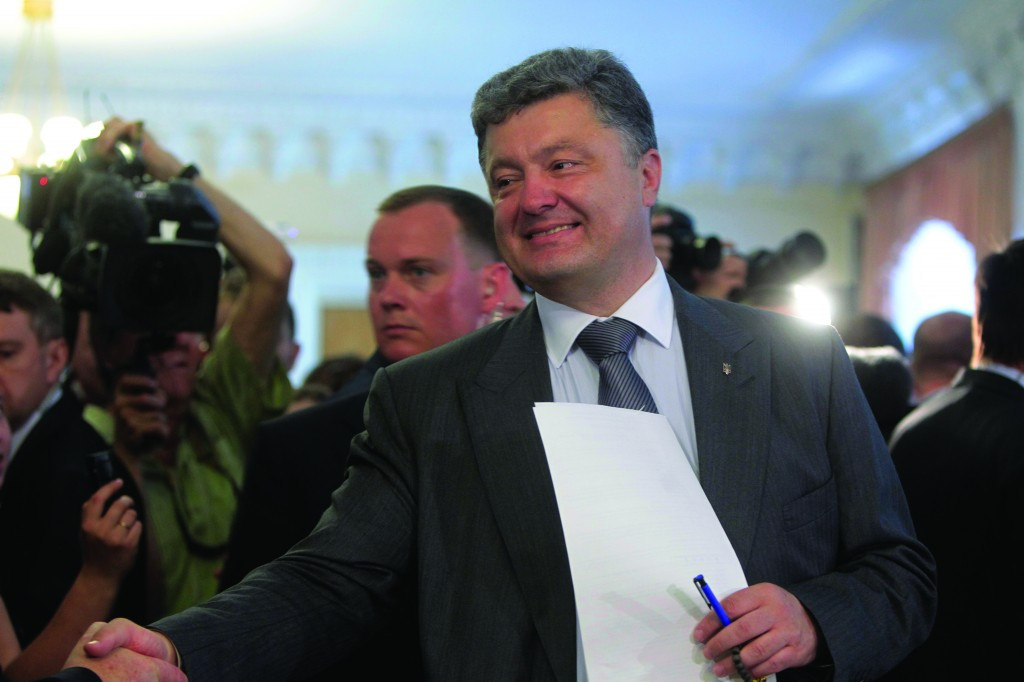 Ukrainian presidential candidate Petro Poroshenko casts his ballot at a polling station during the presidential election in Kiev, Ukraine, on Sunday.  (AP Photo/Sergei Chuzavkov)