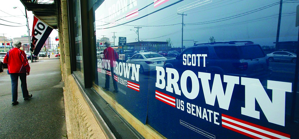 A pedestrian walks past the campaign offices for Republican candidate for the Senate Scott Brown in Manchester, New Hampshire, on May 10. (REUTERS/Brian Snyder)