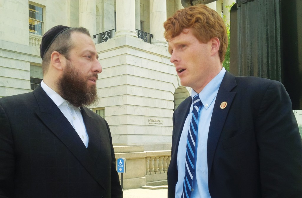 Ezra Friedlander in discussion with Representative Joseph P. Kennedy III after the passing of the legislation.