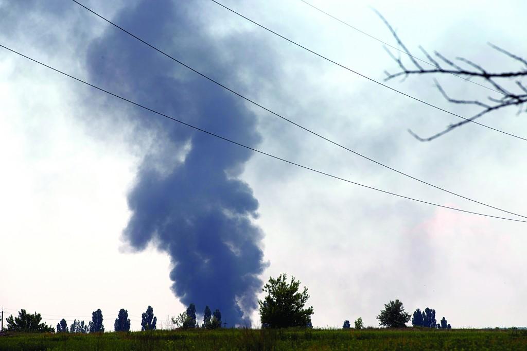 Black smoke rises from a shot down Ukrainian Army helicopter outside Slovyansk, Ukraine, Thursday (AP Photo/Alexander Zemlianichenko)